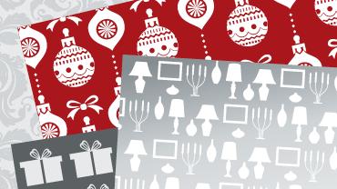 Gemustertes Geschenkpapier in Dunkelrot- und Grautönen