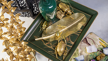 Gold-colored jewellry and decorative elements on a green shell