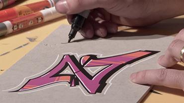 """Der Graffiti-Künstler Carlos Lorente demonstriert sein Können anhand eines stilisierten """"Z""""."""