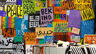 Wall with colorful lettered posters