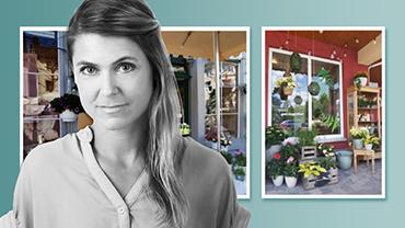 Ein Bild von der Visual-Merchandising-Expertin Julia Nawra vor von ihr gestalteter Ladenfronten